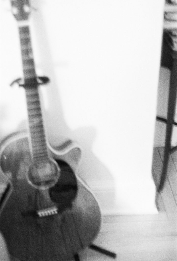 analog bw photo of guitar at home by wendy g photography