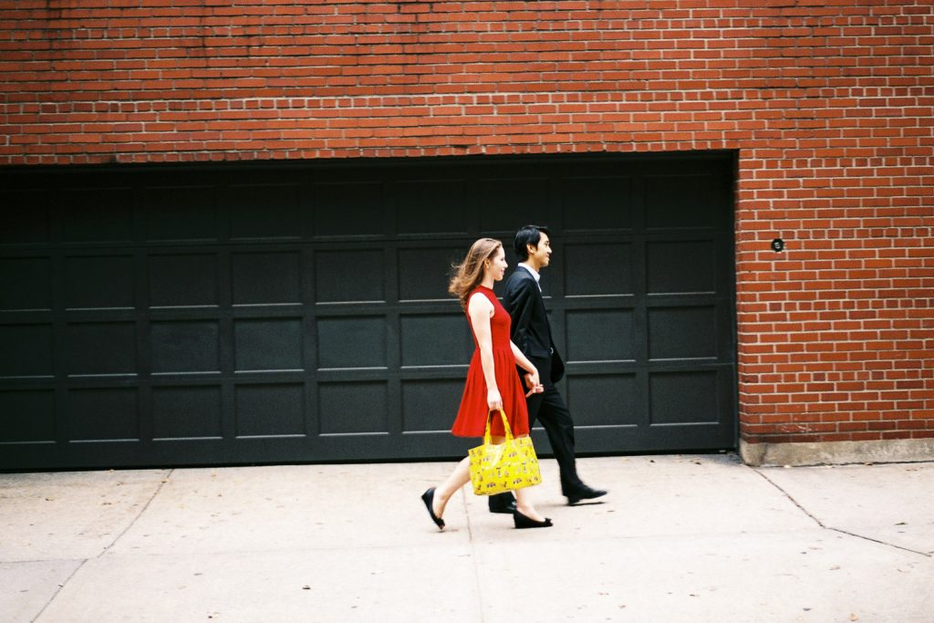 west village engaged couple walking holding by wendy g photography
