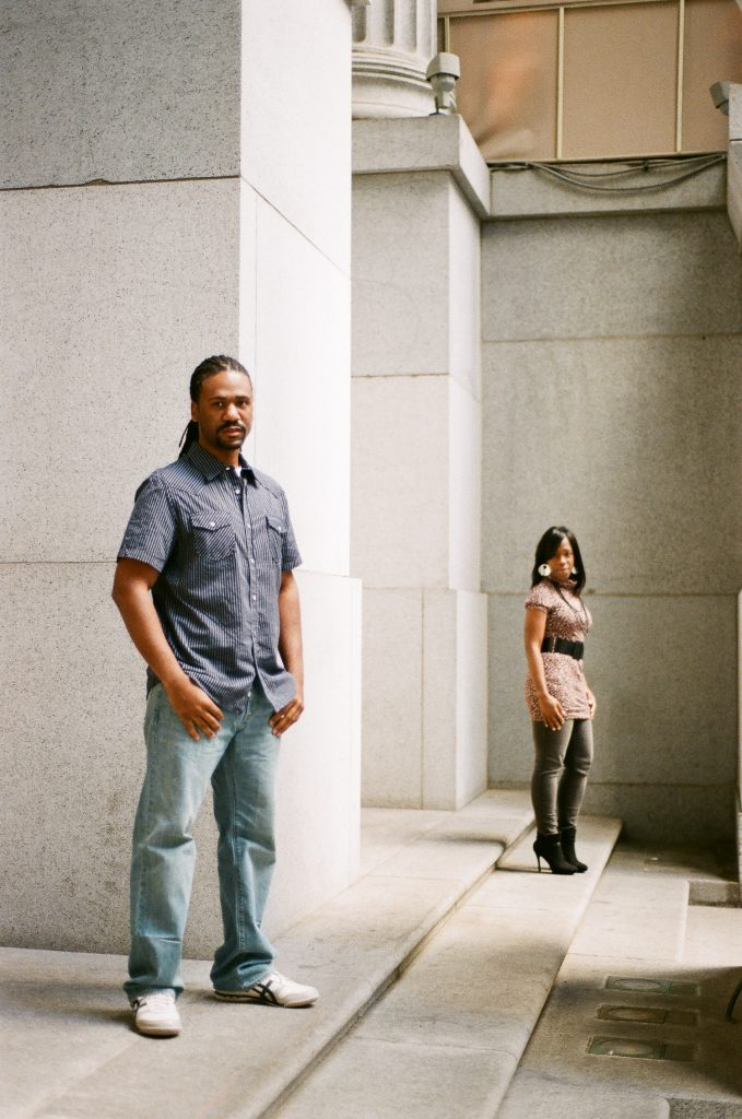 modern engaged couple portrait with groom in the front by wendy g photography