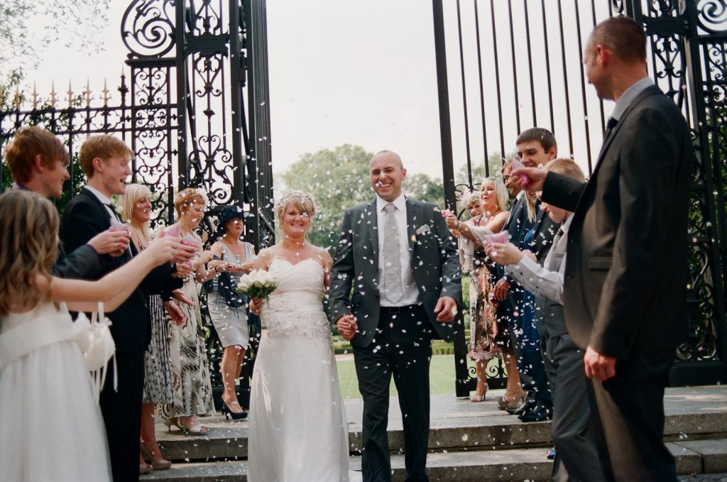 nyc conservatory garden wedding guests throwing rose petals photo by wendy g photography