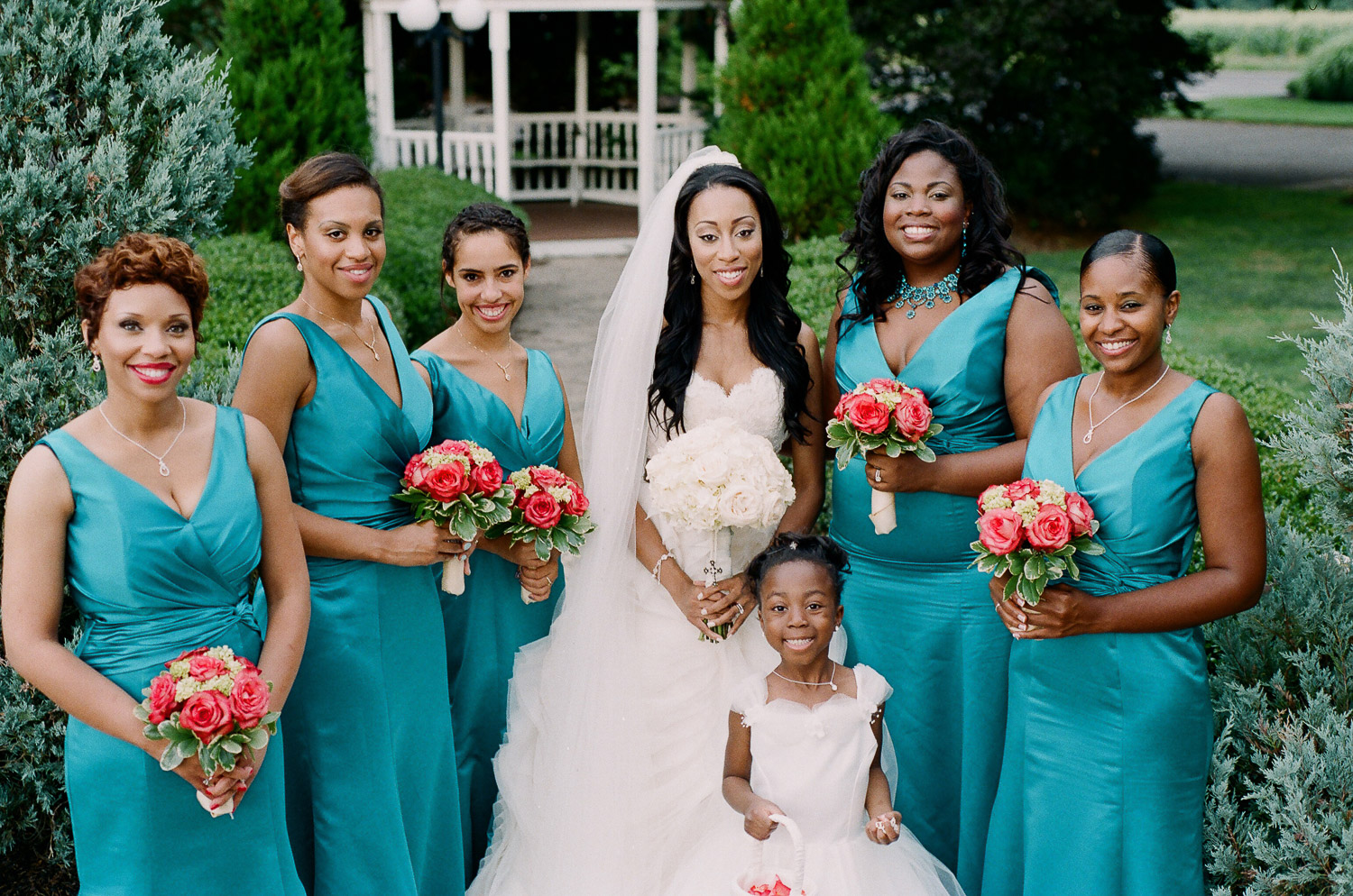 bridesmaids in turquoise dresses and bright bouquets by wendy g photography