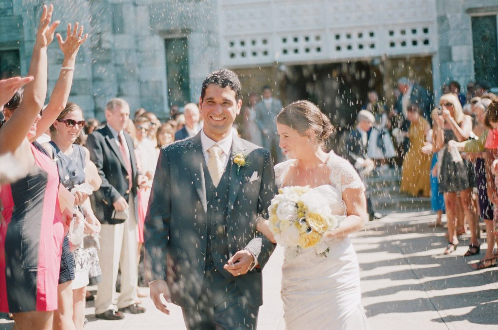 bride and groom exit church after wedding in the hamptons taken by nyc wedding photographer wendy g