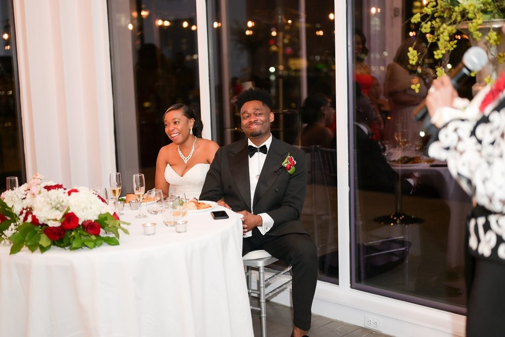 antique loft wedding couple toasts by wendy g photography
