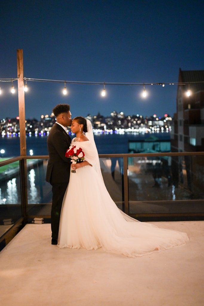 antique loft wedding couple on terrace by wendy g photography