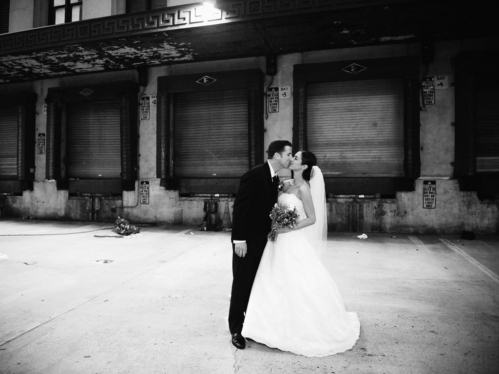 black and white photo of wedding couple kissing in nyc by nyc wedding photographer wendy g