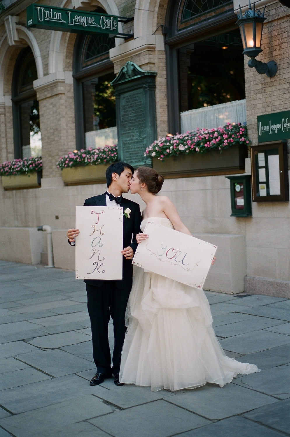 yale wedding couple kissing outside union league cafe wendy g photography