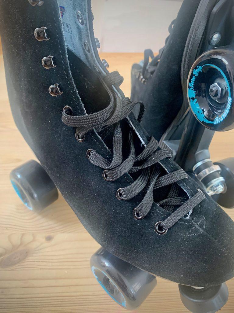 selling black suede sure grip boardwalk skates