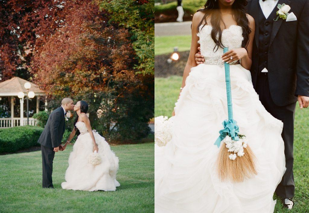 bride and groom holding broom