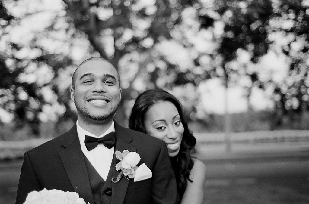 black and white photo of wedding couple smiling